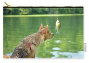 Max Examines The Catch Carry-all Pouch