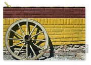 Old Wooden Wheel Against A Wall Carry-all Pouch