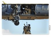 Pararescuemen Are Hoisted Into An Hh-60 Carry-all Pouch