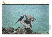 Pelican In Aruba Landing On Lava Rock Carry-all Pouch