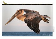 Pelican In Flight At Sunset Carry-all Pouch