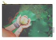 Portrait Of A Girl Holding Gently A Lotus Flower In Her Hands Carry-all Pouch