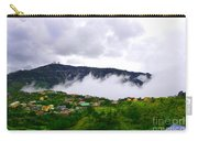 Raging Clouds On The Village Carry-all Pouch