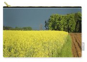 Rapeseed Field With Storm Clouds In Background Carry-all Pouch
