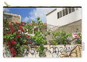 Red Flowers On A Wall Carry-all Pouch