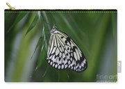 Rice Paper Butterfly Sitting On Green Foliage Carry-all Pouch
