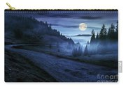 Road Near Foggy Forest In Mountains At Night Carry-all Pouch