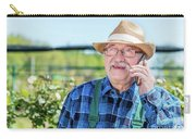 Senior Gardener Talking On The Phone With A Client. Carry-all Pouch