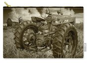 Sepia Toned Old Farmall Tractor In A Grassy Field Carry-all Pouch