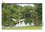Skipping Sandhill Crane By Pond Carry-all Pouch