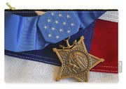 The Medal Of Honor Rests On A Flag Carry-all Pouch