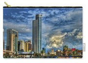 The Skyscraper And Low Clouds Dance Carry-all Pouch by Ron Shoshani