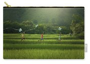 Three Boys Are Happy To Play Kites At Summer Field In Nature In  Carry-all Pouch