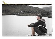 Tourist Seated At Dove Lake Lookout In Tasmania Carry-all Pouch