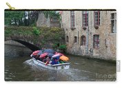 Tourists With Umbrellas In A Sightseeing Boat On The Canal In Bruges Carry-all Pouch