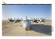 Troops Stand On The Wings Of A C-130 Carry-all Pouch