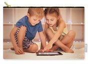 Two Happy Children Playing On The Tablet Carry-all Pouch