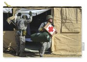 U.s. Air Force Soldier Exits A Medical Carry-all Pouch