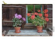 Window And Geraniums Carry-all Pouch by Yair Karelic