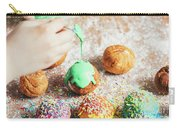 Woman's Hand Coating A Donut With Green Frosting. Carry-all Pouch
