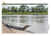 Yacare Caiman On Beach With Passing Boat Carry-all Pouch