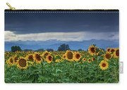Sunflowers Under A Stormy Sky Carry-all Pouch by John De Bord