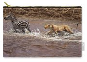 Closing In - Lion Chasing A Zebra Carry-all Pouch by Alan M Hunt