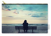 Man In Hood Sitting On A Lonely Bench On The Beach Carry-all Pouch