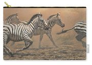 The Race - Zebras Carry-all Pouch by Alan M Hunt