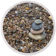 Cairn On Wet Pebbles Round Beach Towel