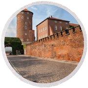 Sandomierska Tower And Wawel Castle Wall In Krakow Round Beach Towel