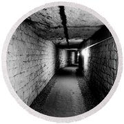 Image Of The Catacomb Tunnels In Paris France Round Beach Towel