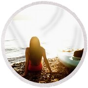 A Beautiful Young Woman Relaxes Round Beach Towel