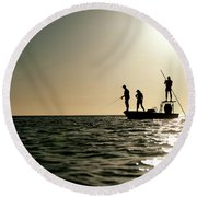 A Couple Fish As A Man Pilots A Small Round Beach Towel
