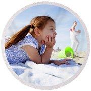 A Cute Little Hispanic Girl In A Summer Round Beach Towel