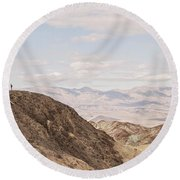 A Hiker Stands On A Peak Round Beach Towel