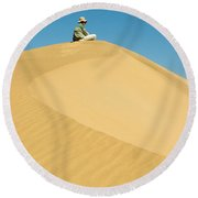 A Man Sits Atop A Dun In The Namib Round Beach Towel
