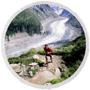 A Man Trail Runs In Chamonix, France Round Beach Towel