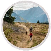 A Mother And Daughter Mountain Biking Round Beach Towel