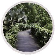 A Raised Walking Path Inside The National Orchid Garden In Singapore Round Beach Towel