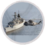 A Royal Navy Merlin Helicopter Passes Over Hms Cumberland Round Beach Towel