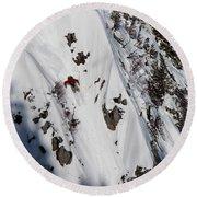 A Telemark Skier In A Narrow Chute Round Beach Towel