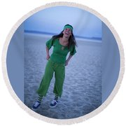 A Woman Having Fun On The Cracked Earth Round Beach Towel