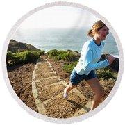 A Woman Running Stairs Near The Ocean Round Beach Towel