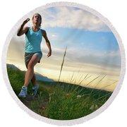 A Woman Trail Running Near Boulder, Co Round Beach Towel