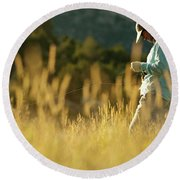 A Young Man Fly-fishing At Sunset Round Beach Towel