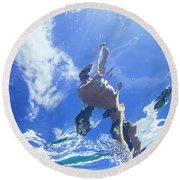 A Young Man Stand-up Paddleboards Round Beach Towel