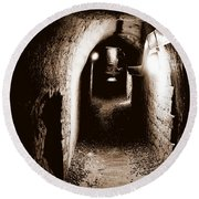 A Tunnel In The Catacombs Of Paris France Round Beach Towel