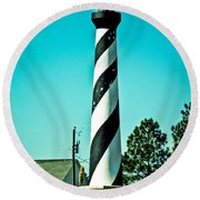An Image Of Lighthouse In Small Town Round Beach Towel