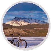 Bike On Frozen Lake Laberge Yukon Canada Round Beach Towel